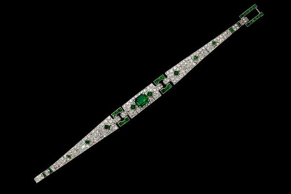 Cartier platinum, diamond and emerald line bracelet, circa 1927.