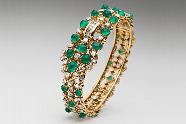 Cartier gold, diamond and emerald bangle, circa 1958.